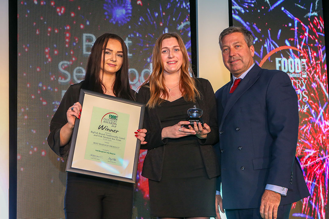 BEST SEAFOOD PRODUCT: BigFish Brand Traditionally Cured and Oak Smoked Sea Trout – JCS Fish Limited L-R: Category partner Hollie Toplis of Dawsonrentals Temperature Control Solutions with award winner Jessica Pritchett of JCS Fish Limited and chef John Torode.